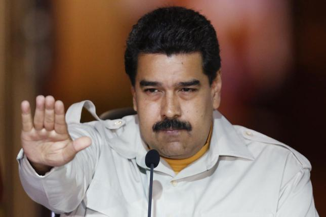 Venezuela's President Nicolas Maduro gestures during a meeting with supporters at Miraflores Palace in Caracas